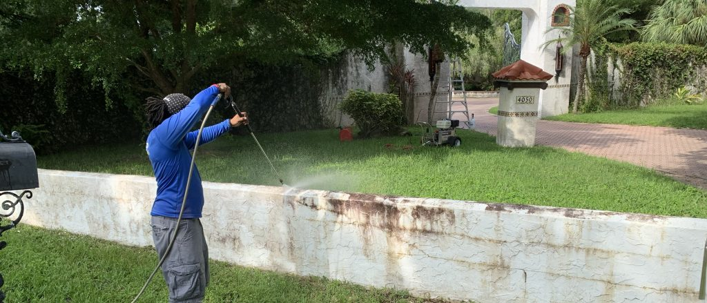 Edified Services power wash worker